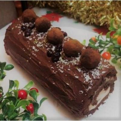 un gâteau en forme de bûche pour Noël